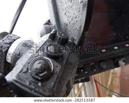 Professional digital video camera.  closed polyethylene camcorder against rain. - stock photo