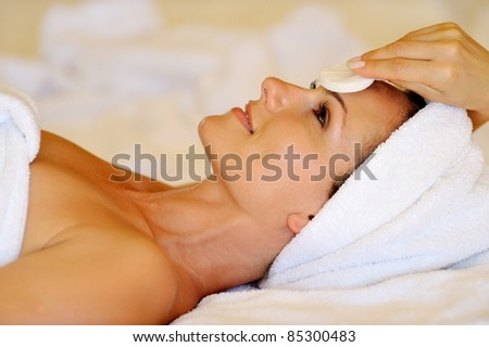 profile view of happy young woman preparing for cosmetic treatment - stock photo