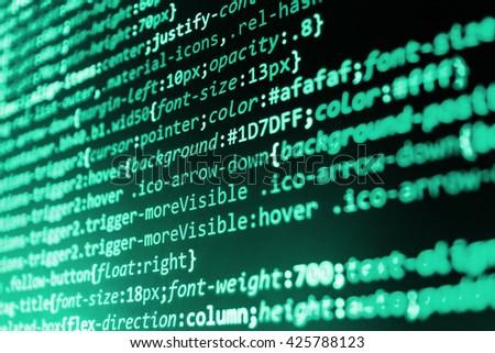 Programmer workplace. Website programming code. Software development. Technology background. Developer working on websites codes in office. Programmer occupation. Source code photo.   - stock photo