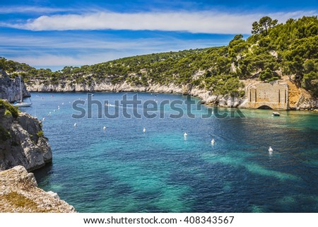 Provence, France, spring. Abrupt stony coast and turquoise sea surface. Famous National Park Calanques on the Mediterranean coast - stock photo