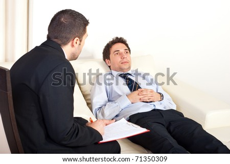 Psychiatrist man talking  with hypnotized male patient - stock photo