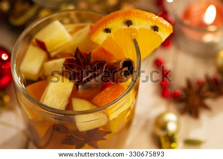 Punch with orange,apple and spices.Hot drinks for winter and Christmas - stock photo