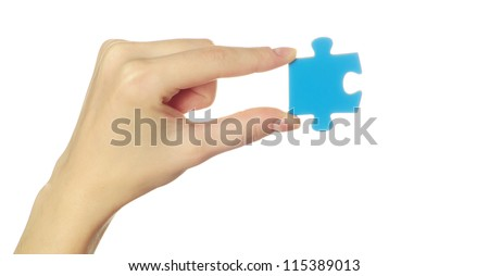 puzzle in hand isolated on white background - stock photo