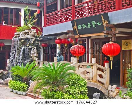 QIBAO, SHANGHAI-SEPTEMBER 4: village ancient hotel. Qibao water village is Shanghai tourist attraction with 1000000 visitors year. September 4, 2004 Qibao, Shanghai.         - stock photo
