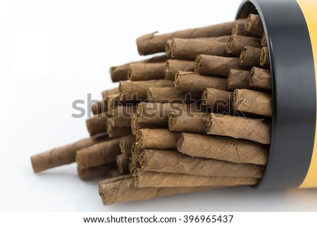 Quality cigars and tobacco leaves in the box on white background, Handmade cigar, Thailand - stock photo