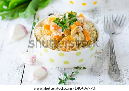 Quinoa with pumpkin . Selective focus - stock photo