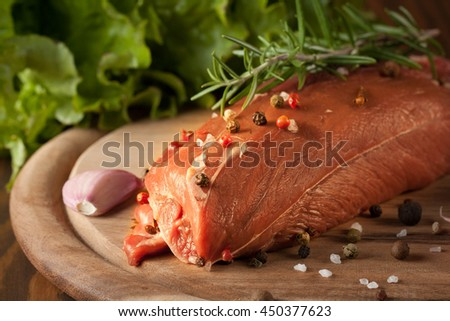 Raw fresh beef meat full steak with rosemary, pepper, tomatoes, garlic, salad and salt on wooden background - stock photo