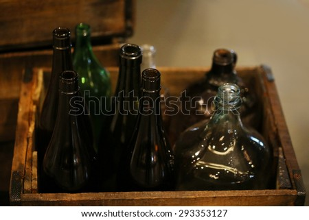 recycle old glass bottle in wood box ,large heap of empty green wine bottles - stock photo