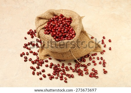 Red adzuki beans and bag      - stock photo