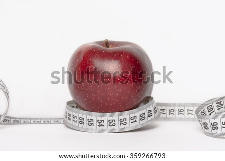 Red apple with measuring tape diet concept isolated on white background - stock photo