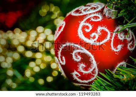 Red christmas ball. Christmas bauble  on defocused background - stock photo