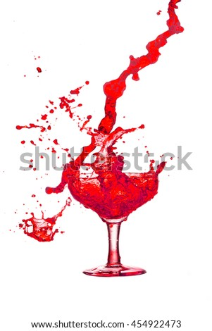 Red cocktail glass splash out on a white background.  - stock photo