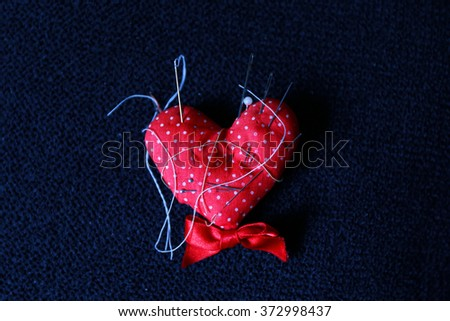 red heart ,pinheads in pin-cushion  - stock photo