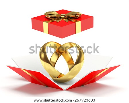 Red open gift box with golden wedding rings isolated on white background - stock photo