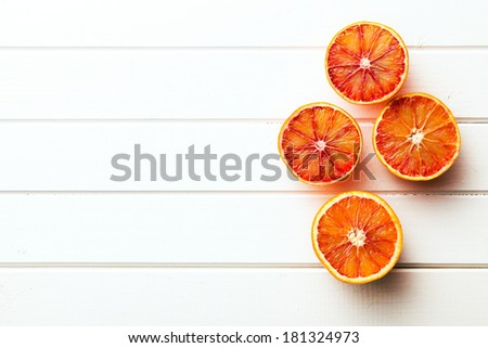 red oranges on kitchen table - stock photo