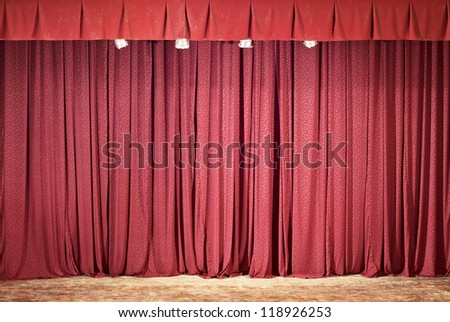 Red theater curtain, lights and shadows - stock photo
