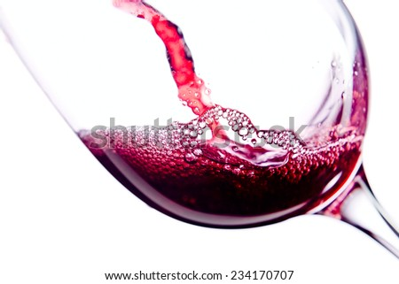 Red wine in wineglass on white background - stock photo