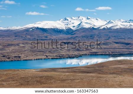 Reflection of Joseph Ridge in Lake Alexandrina, from Mt John, Tekapo, South Island, New Zealand - stock photo