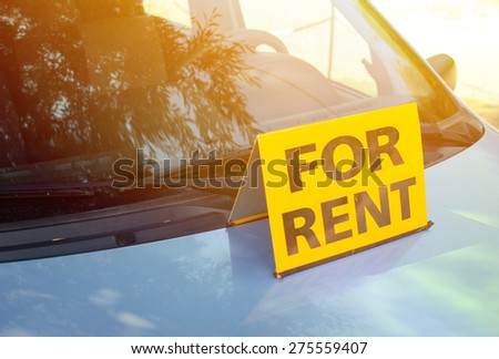"""RENT A CAR"" sign on car - Rent a car concept - stock photo"