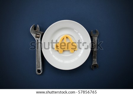 repair. Composition from metalwork tools and the car from cheese on a plate. - stock photo