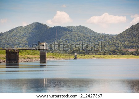 Reservoir in sunnyday with mountain in the background - stock photo
