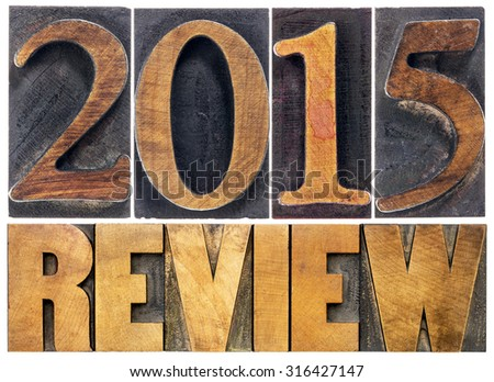 2015 review - annual review or summary of the recent year - isolated text in letterpress wood type blocks - stock photo