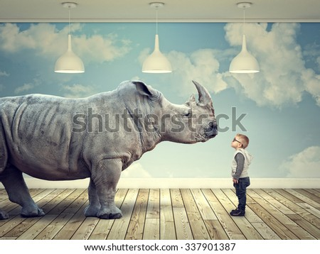 rhinoceros and kid in abstract 3d indoor - stock photo