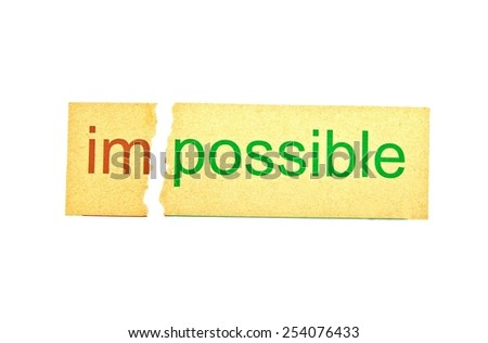 Rip paper for changing word impossible to possible. Conceptual of successfully overcoming problems.  - stock photo