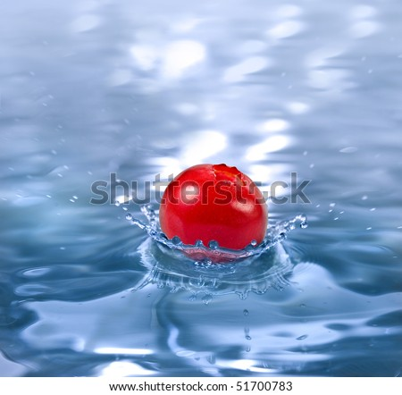 ripe berry cranberry falling in a refreshing drink with copy space - stock photo