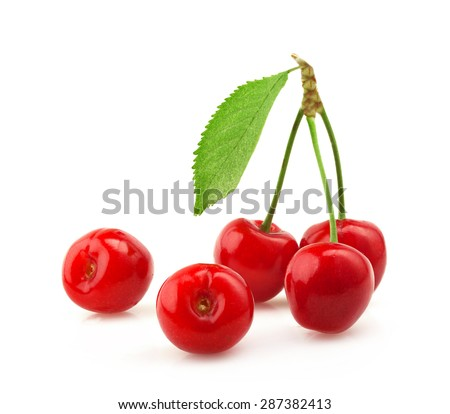 Ripe cherries with a leaf on a white background. - stock photo