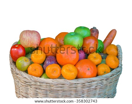 Ripe fruits in wicker basket on white background - stock photo