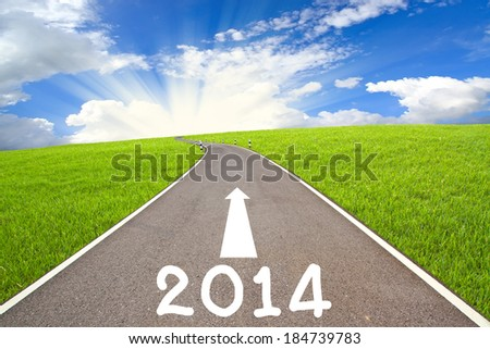 2014 Road and cloudy sky - stock photo