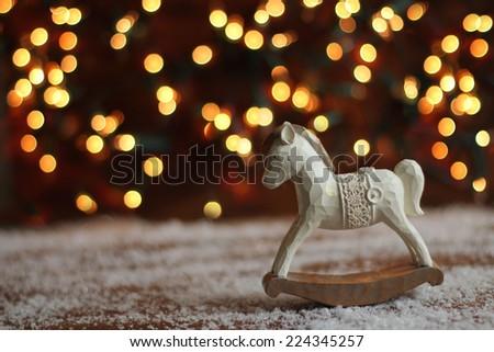 rocking horse on christmas background - stock photo