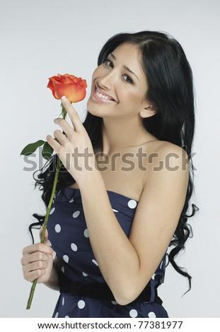 romantic pretty woman holding a rose - stock photo