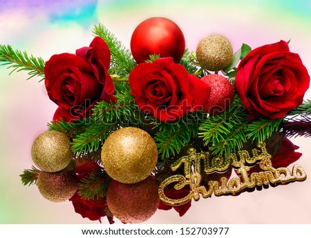 roses and golden baubles are on a mirror table - stock photo