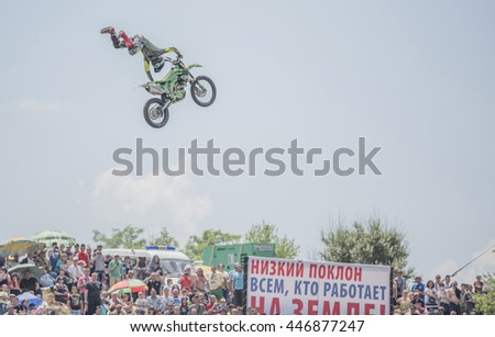 Rostov-on-Don, Rostov region, Russia- June 05,2016: Motofreestyle - jumps with incredible acrobatic elements on Bizon Track Show - stock photo