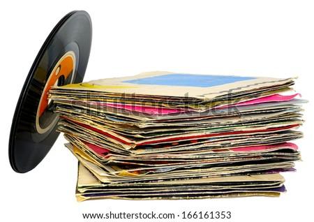 45 rpm vinyl discs stack on white background - stock photo