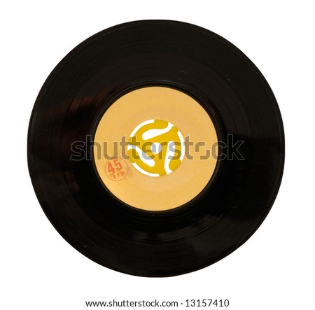 45rpm vinyl record with adapter in center. Grungy label with scratches at 100%. - stock photo