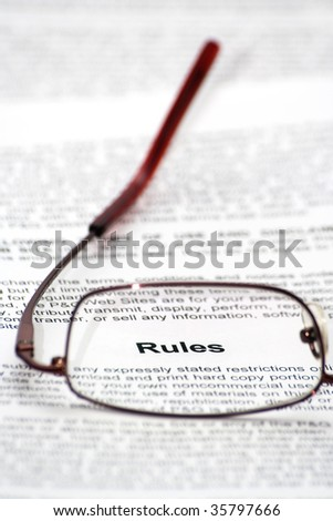 """Rules"" word focused thought glasses - stock photo"