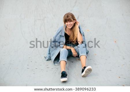 90's style girl in the skatepark - stock photo