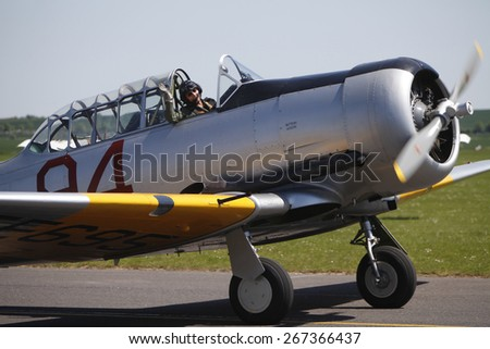 1950s vintage Harvard pilot training aircraft at the Flying Legends Air Display held at Duxford airfield,Cambridgeshire,UK.taken 14/07/2013 - stock photo