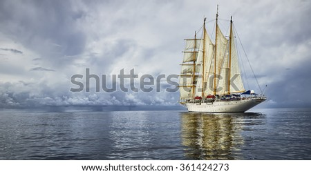 Sailing ship and a beautiful seascape with storm clouds.  Yachting. Sailing - stock photo