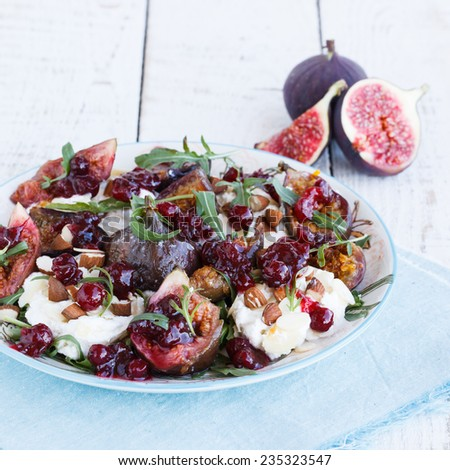 Salad with figs and arugula - stock photo
