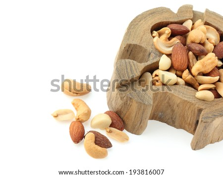 salted cocktail nuts on white background - stock photo