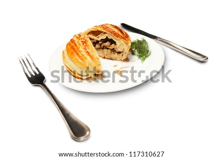 Samosa stuffed with minced meat cut ??on a plate on a white background isolated. A series of food in a restaurant close-up - stock photo