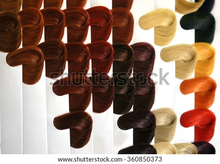 sample of hair color, Locks of hair dyed in various shades - stock photo