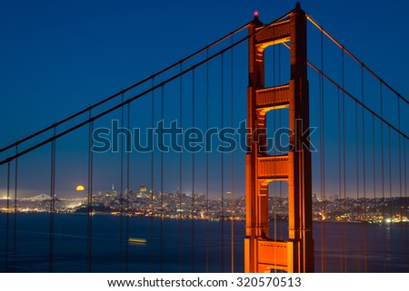 San Francisco city with the Golden Gate Bridge at the full moon day, SF, USA. - stock photo