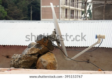 Satellite dish on roof in Debark, Ethiopia - stock photo