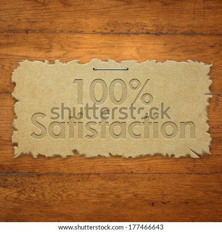 100% satisfaction on torn paper - stock photo