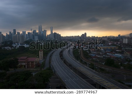 scenery of elevated highway heading towards Kuala Lumpur city centre during sunset - stock photo